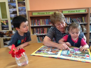 Peg shares the joys of books with Noah and Ayda Daly